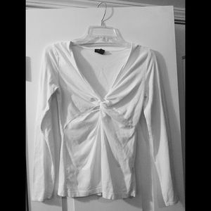 White long sleeved top with v neck. Make an offer